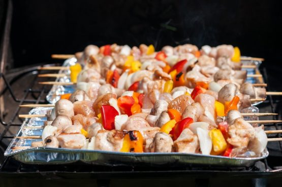 preparation for the barbecue – raw skewers on a tray